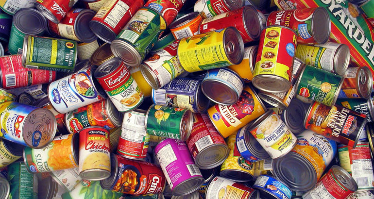 Choosing canned food (packed in cans)